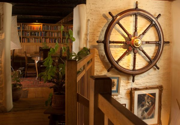 Traditional ships wheel on inside the ship inn