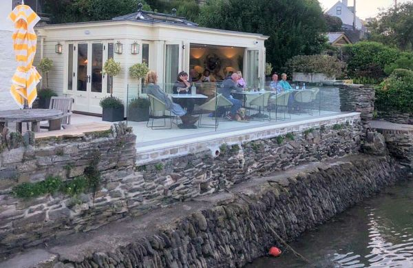 The Glass House at the Ship Inn - Guests sat outside enjoying the waterside view