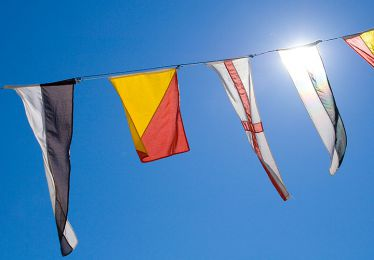Decorative flags and pendants on a blue sky