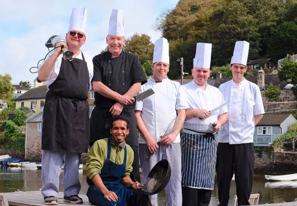 The Head Chef with his happy & loyal team